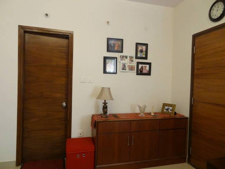 Apartment in NCC Urban Gachibowli.:  Bedroom by Freelance Designer