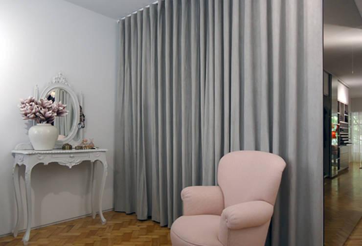 Loja Prassa Mulher, Porto: Lojas e espaços comerciais  por ASVS Arquitectos Associados