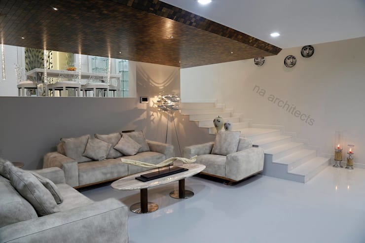 Residential project:  Living room by NA ARCHITECTS