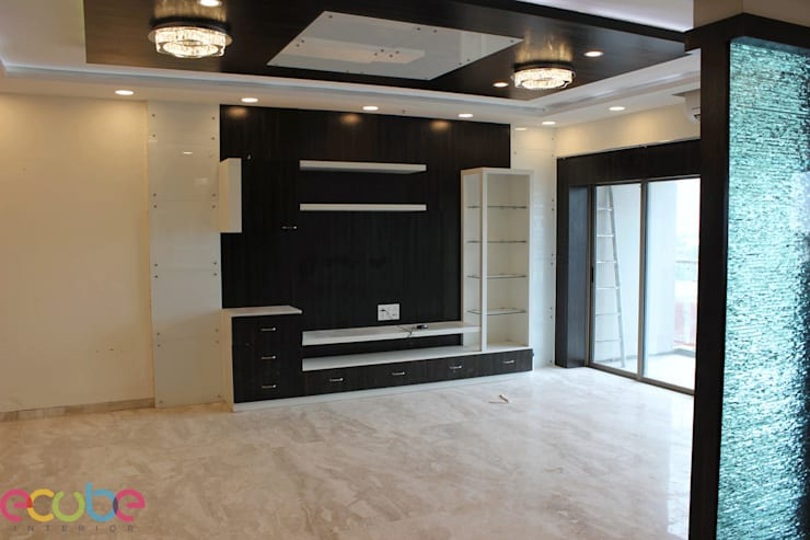 Residential Appartment @ Phoenix Market city—Chennai:  Living room by ECUBE INTERIOR SOLUTIONS PVT LTD,Country Plywood