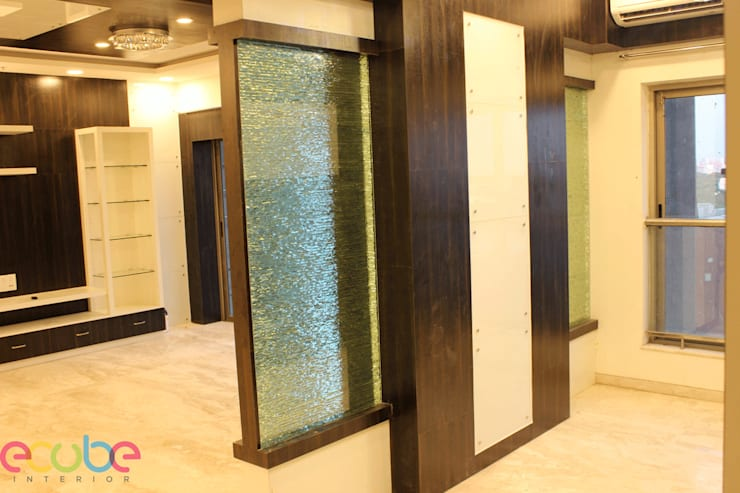 Residential Appartment @ Phoenix Market city—Chennai:  Corridor & hallway by ECUBE INTERIOR SOLUTIONS PVT LTD,Country Plywood