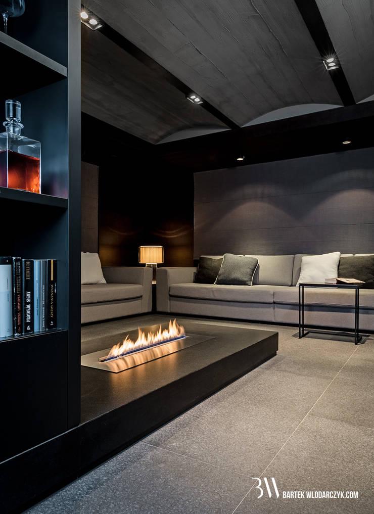 Salon kominkowy: styl , w kategorii Salon zaprojektowany przez Bartek Włodarczyk Architekt