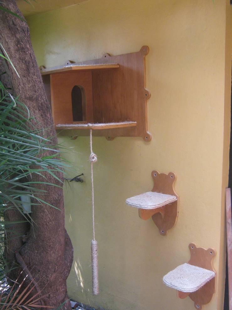 casita para gatos: Jardín de estilo  por L atelier