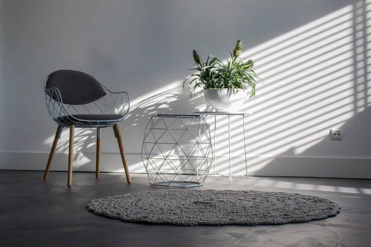 Salas de estilo  por Motion Gietvloeren