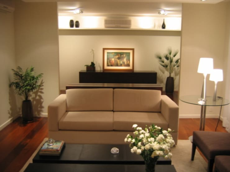Apartamento em Pinheiros: Salas de estar  por Leonardo Bachiega Arquitetos,Moderno