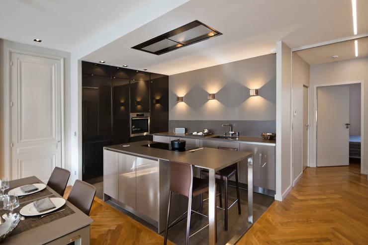 Appartement Lyon 06: Cuisine de style de style Moderne par Tymeno