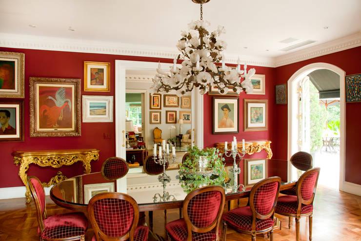 Dining room by Allan Malouf Arquitetura e Interiores