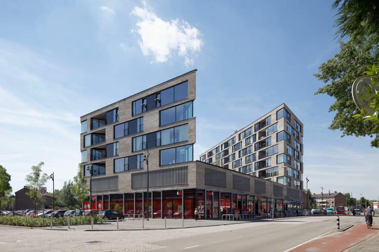 appartementen en commerciële voorzieningen:  Huizen door JMW architecten, Modern Stenen