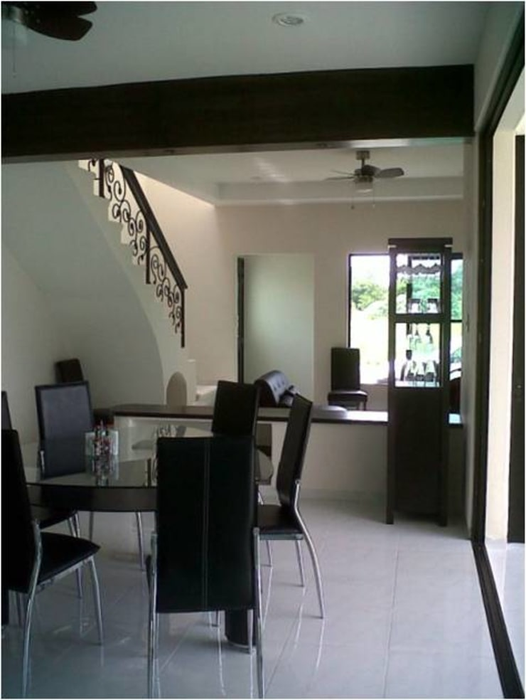 Casa Privada 21: Comedores de estilo  por Constructora e Inmobiliaria Catarsis