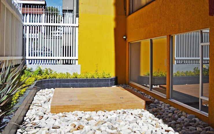 APARTAMENTO 62: Jardines de estilo  por santiago dussan architecture & Interior design