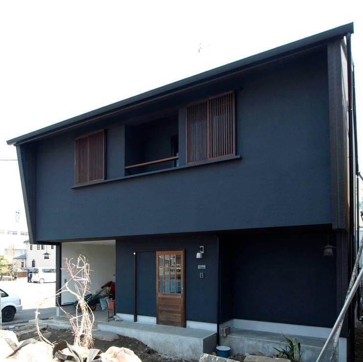 Casas de estilo  por アトリエdoor一級建築士事務所