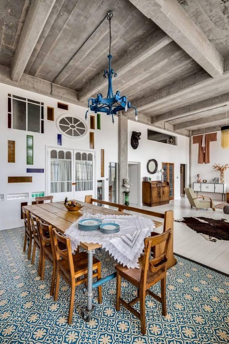 O estilo vintage de Hackney: Salas de jantar  por MOSAIC DEL SUR