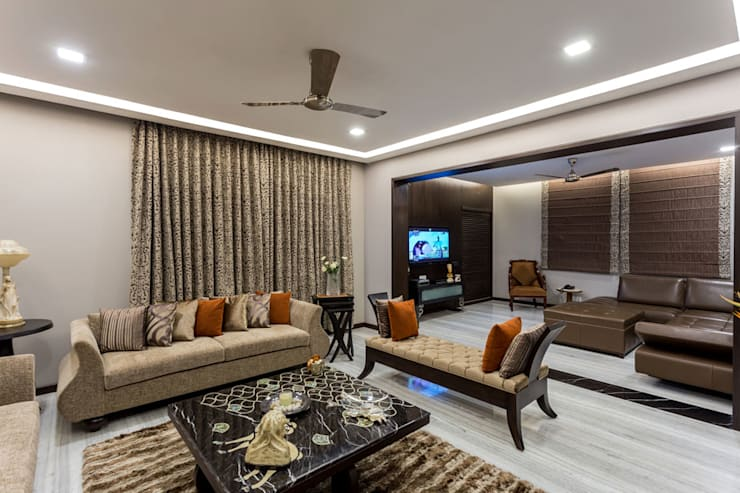 Kumar Residence:  Living room by Spaces and Design
