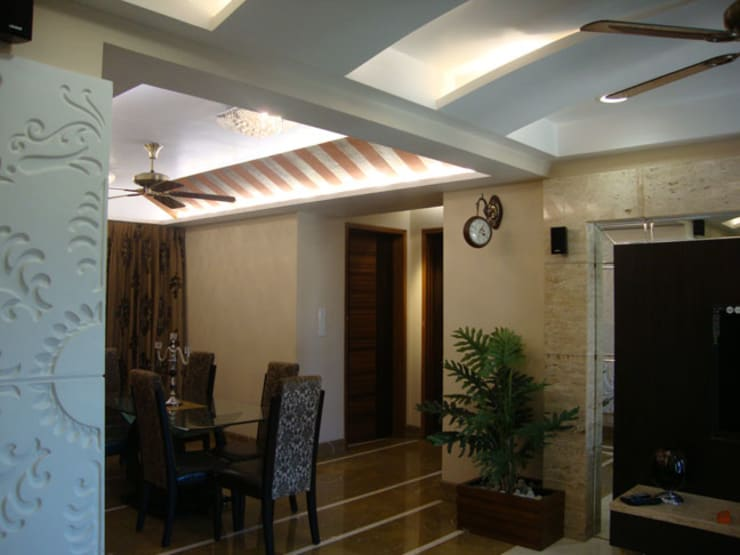 Chowdhary Residence:  Dining room by Spaces and Design