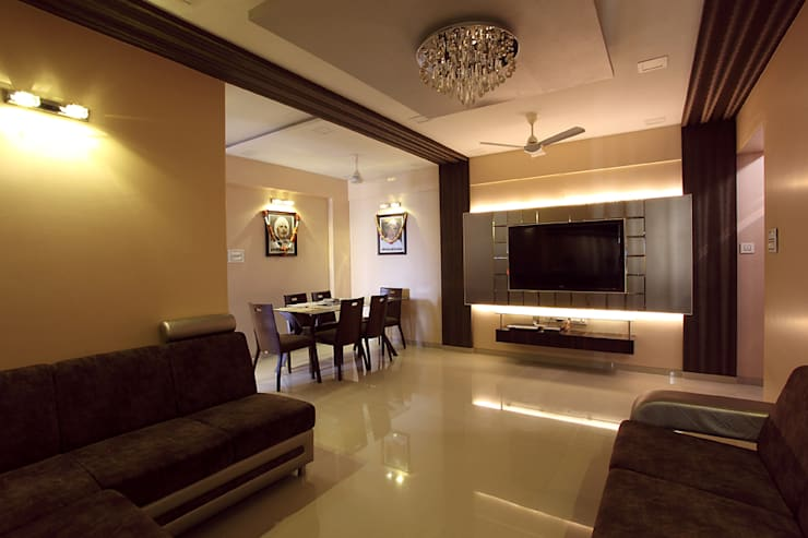 Harish Bhai:  Dining room by PSQUAREDESIGNS