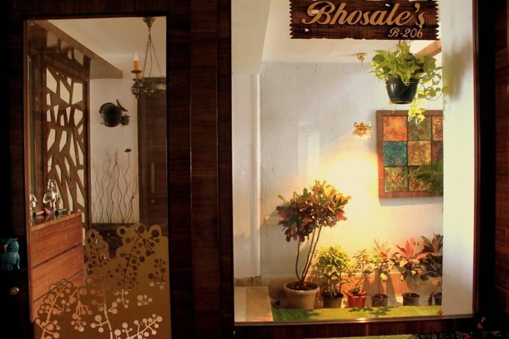 Seaview Apartment at Palm Beach Residency at Navi Mumbai:  Windows by Shweta Deshmukh & Associates