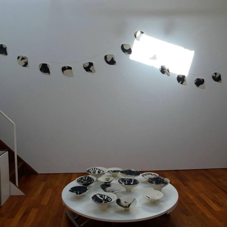A Spring into Myself: Ricca OKANOが手掛けたリビングルームです。,
