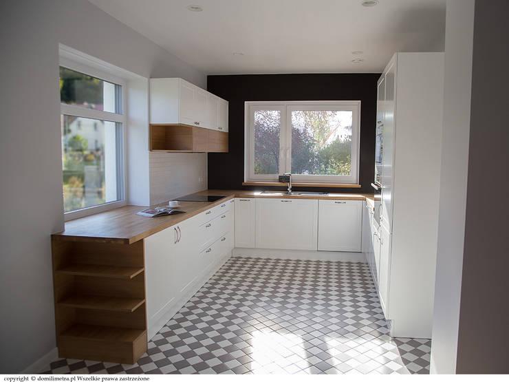 Widok kuchni z salonu: styl , w kategorii Kuchnia zaprojektowany przez DoMilimetra