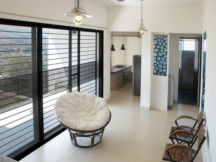 Residential project:  Corridor & hallway by JPA Tulja Interiors Pvt. Ltd.