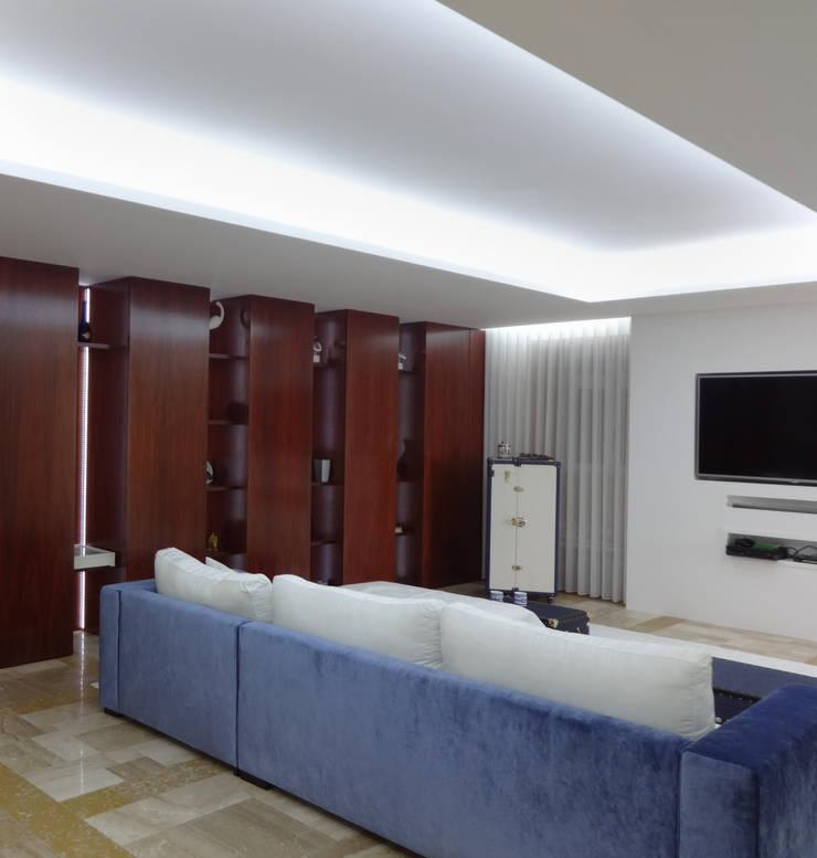 Sala de estar – Habitação Unifamiliar: Salas de estar  por Método-Arquitectura & Decoração