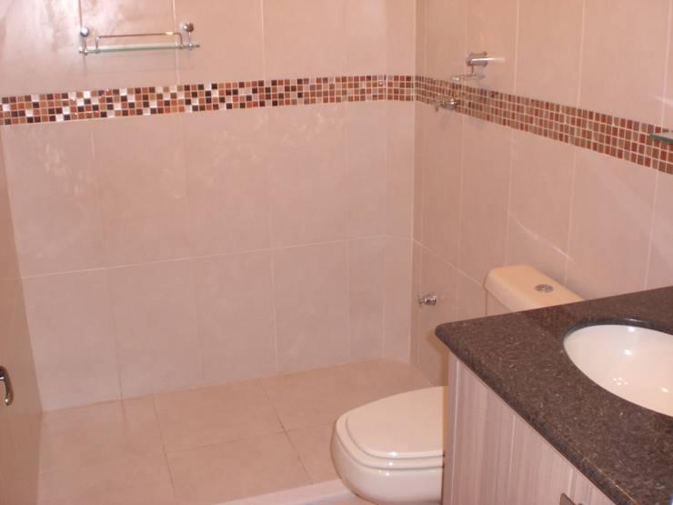Banheiro da suite: Banheiros  por Graziela Alessio Arquitetura,