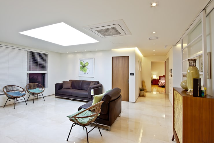 Salas / recibidores de estilo  por THE JK