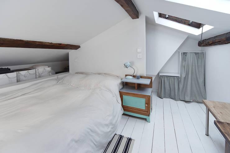 28m2: Chambre de style  par Croisle Architecture