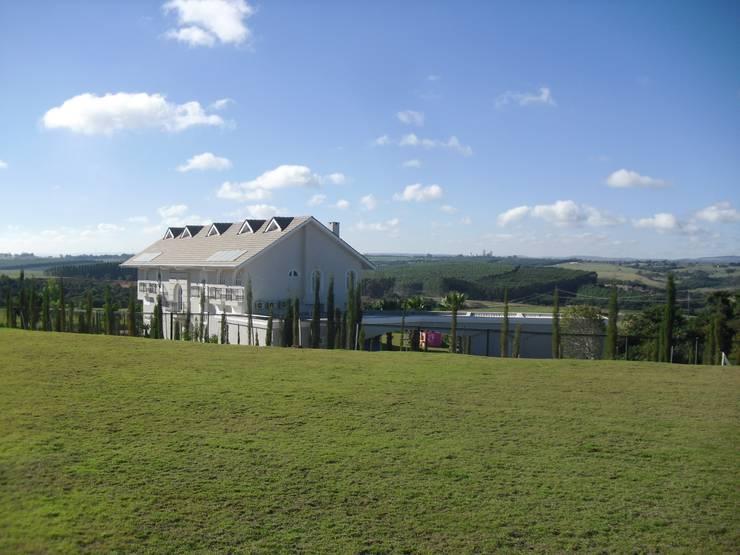 Casa de campo em Salto de Pirapora: Casas  por GATE Arquitetos Associados