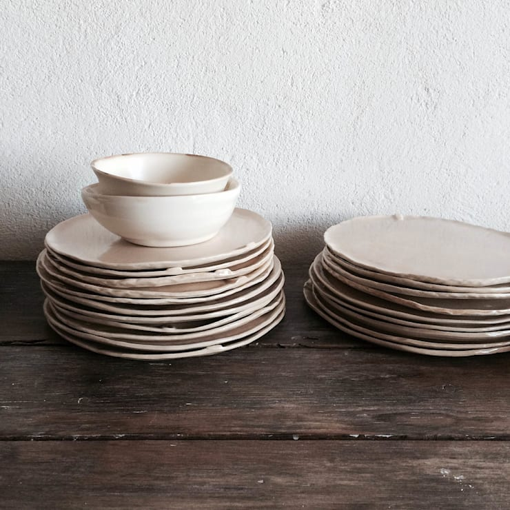 VAGO plates and bowls: Cozinha  por Margarida Fabrica