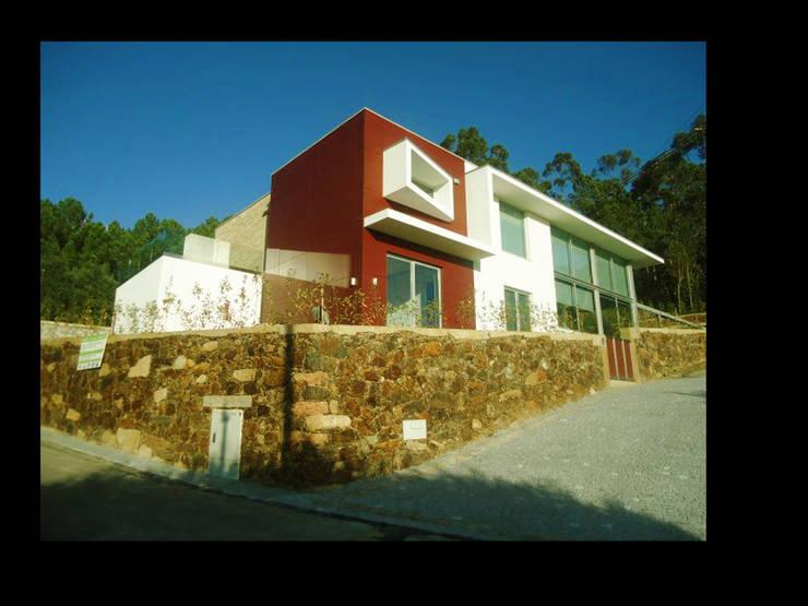 MORADIA CAMPO DE GOLF: Casas  por MDArquitectos