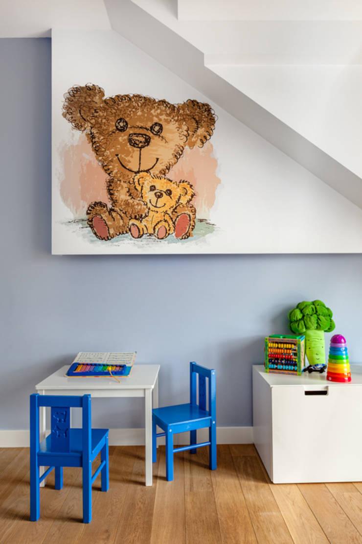 Our photoshoot of apartment design by Decocafe Architects: styl , w kategorii Pokój dziecięcy zaprojektowany przez Ayuko Studio ,Nowoczesny