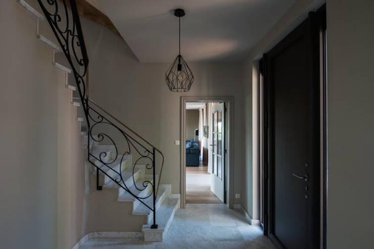 Projekty,  Korytarz, przedpokój zaprojektowane przez BURO5 - architectes & associés