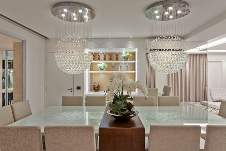 Projekty,  Jadalnia zaprojektowane przez Designer de Interiores e Paisagista Iara Kílaris