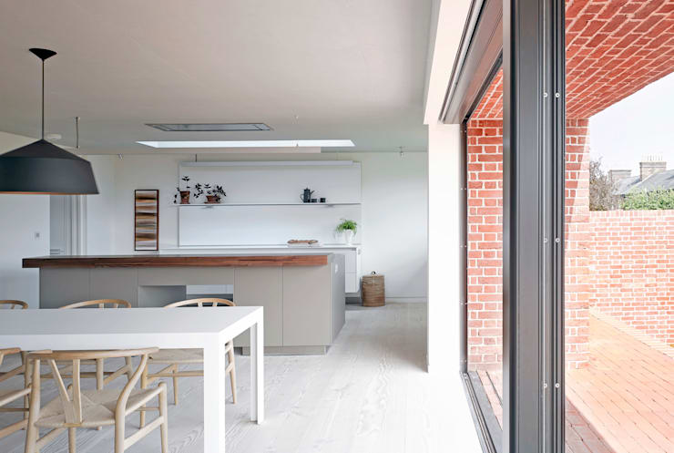 View of the kitchen from the dining area at the house at Broad Street in Suffolk:  Kitchen by Nash Baker Architects Ltd