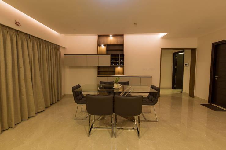 Apartment Interiors:  Dining room by Studio Stimulus