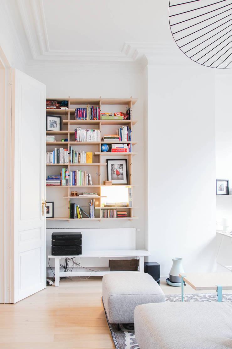 Rénovation d'un appartement bruxellois: Salon de style  par Alizée Dassonville | architecture