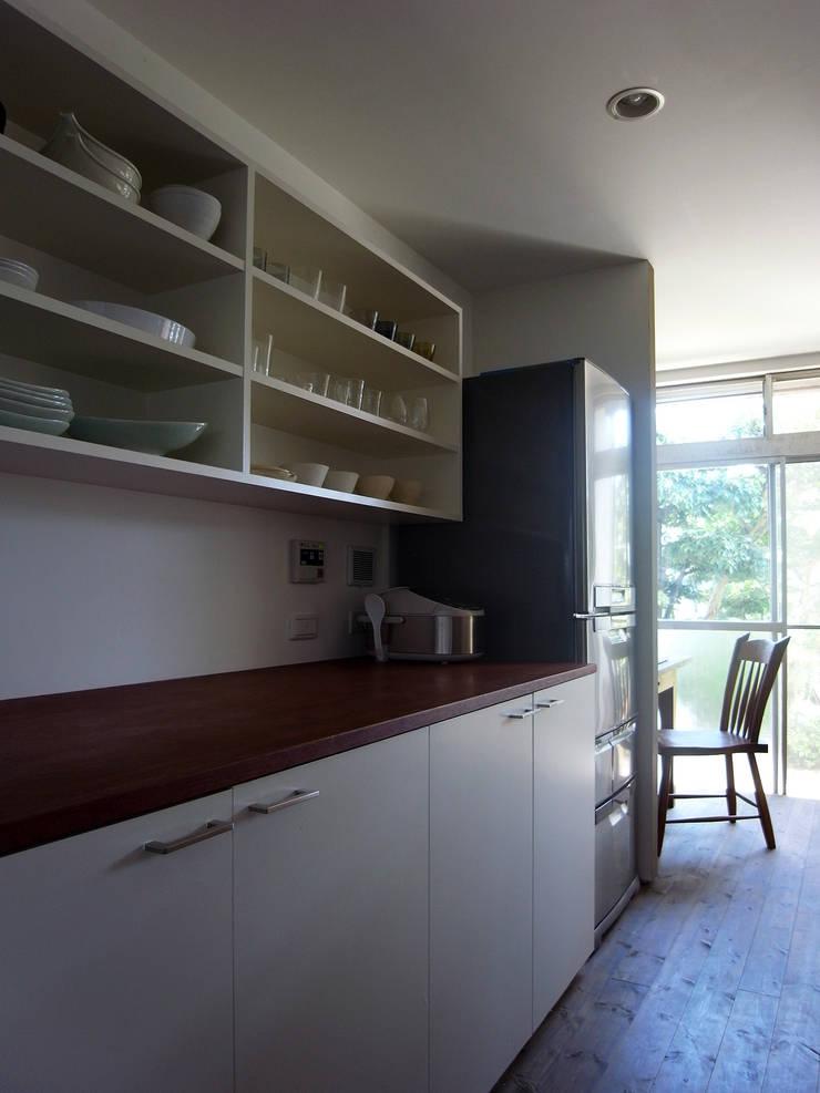 新千里の家: 村松英和デザインが手掛けたキッチンです。