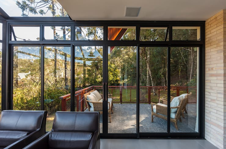 Casa das Primaveras: Casas  por VNK Arquitetura e Interiores