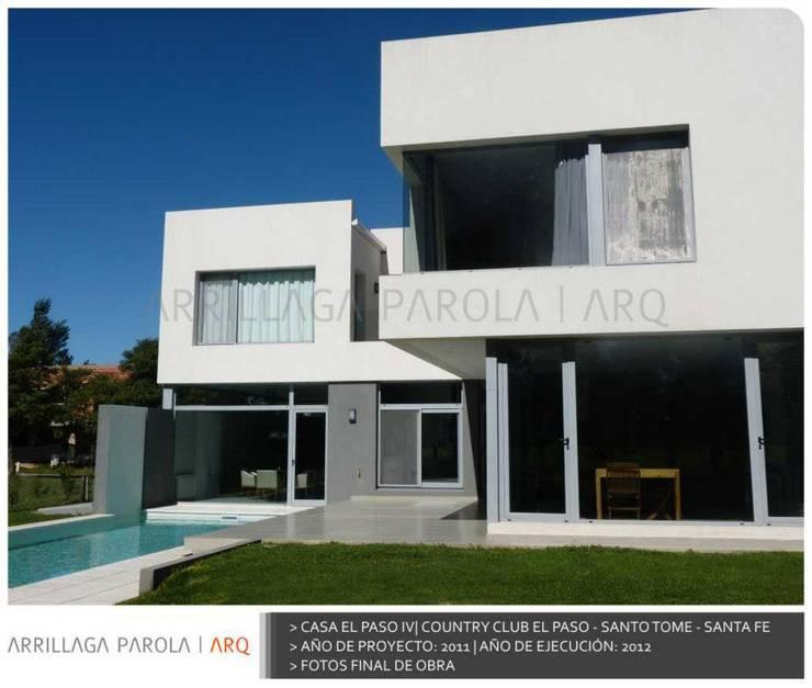 Casa El paso IV: Casas de estilo  por ARRILLAGA&PAROLA