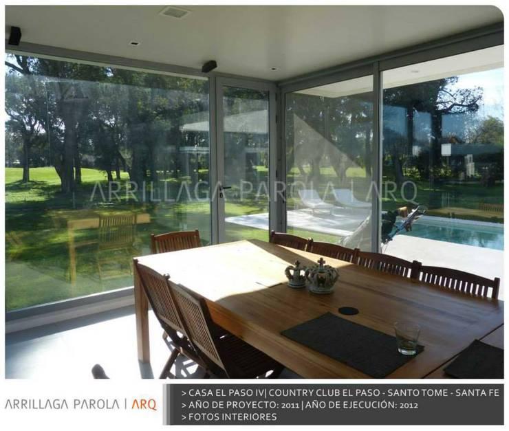 Casa El paso IV: Terrazas de estilo  por ARRILLAGA&PAROLA