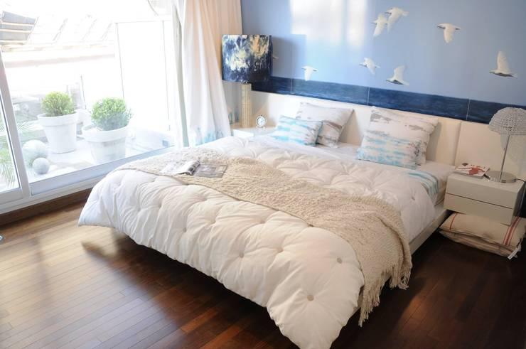 Zencity : Dormitorios de estilo moderno por victorialosada