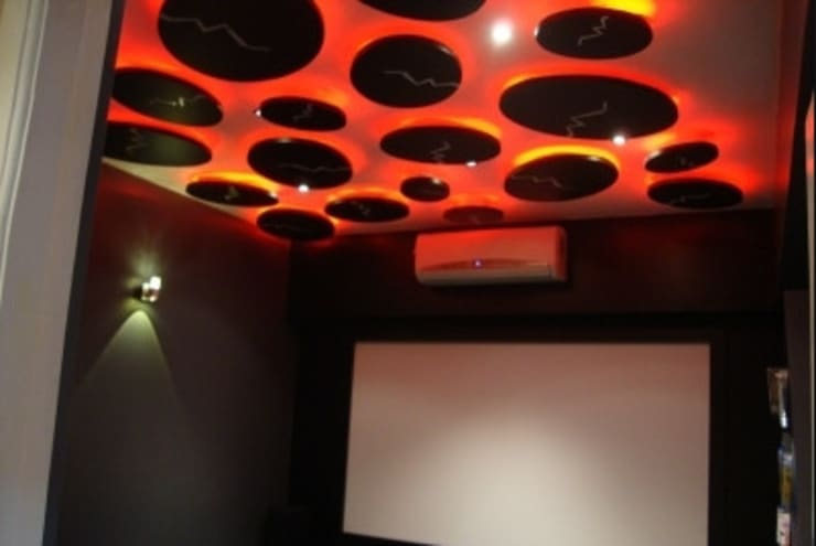 Personal Theater:  Media room by Takeaway Interiors