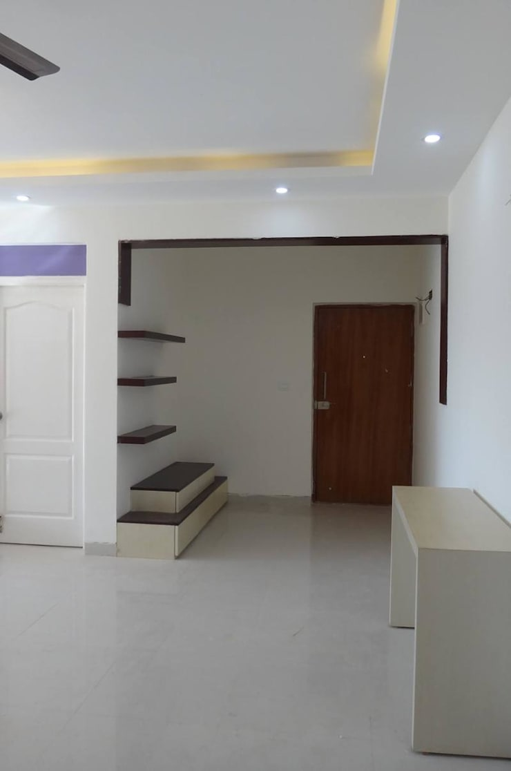 Mr.Vikas interiors:  Living room by Storytellers Design Studio