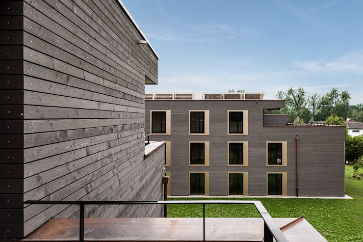 Fassdendetail:  Häuser von Giesser Architektur + Planung,Modern Holz Holznachbildung