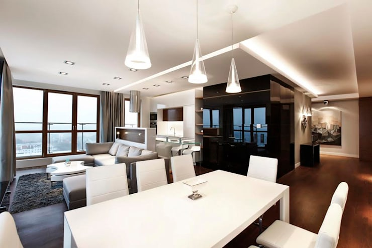 Mieszkanie w chmurach / Apartament in the clouds: styl , w kategorii Salon zaprojektowany przez FLOW Franiak&Caturowa