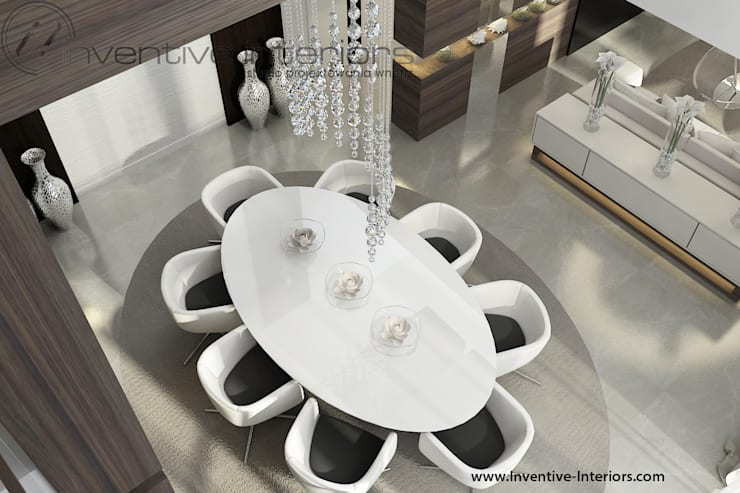 Owalny stół w wysokiej jadalni: styl , w kategorii Jadalnia zaprojektowany przez Inventive Interiors,Nowoczesny