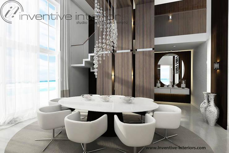 Owalny stół w wysokiej jadalni: styl , w kategorii Jadalnia zaprojektowany przez Inventive Interiors,Nowoczesny Drewno O efekcie drewna
