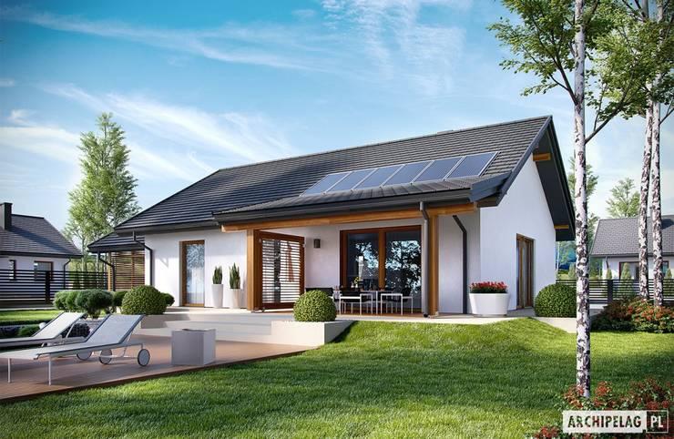 Projekt domu Kornel VI (z wiatą) ENERGO : styl , w kategorii Domy zaprojektowany przez Pracownia Projektowa ARCHIPELAG