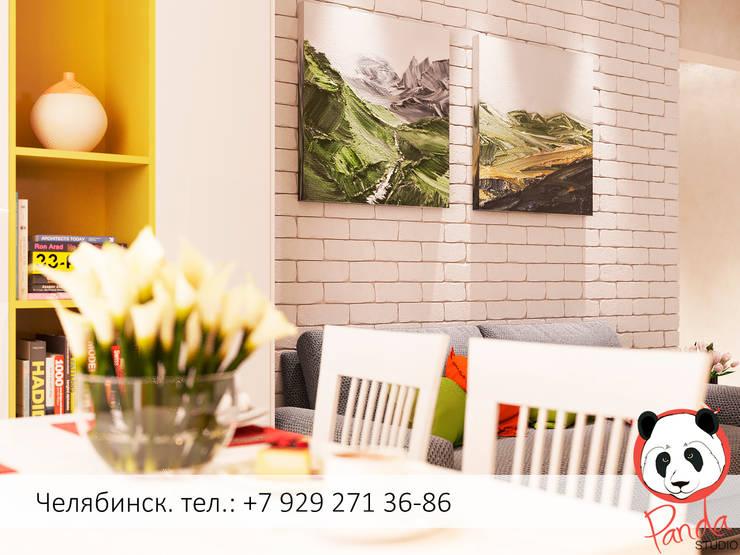 Colourful living room: modern Living room by Panda Studio