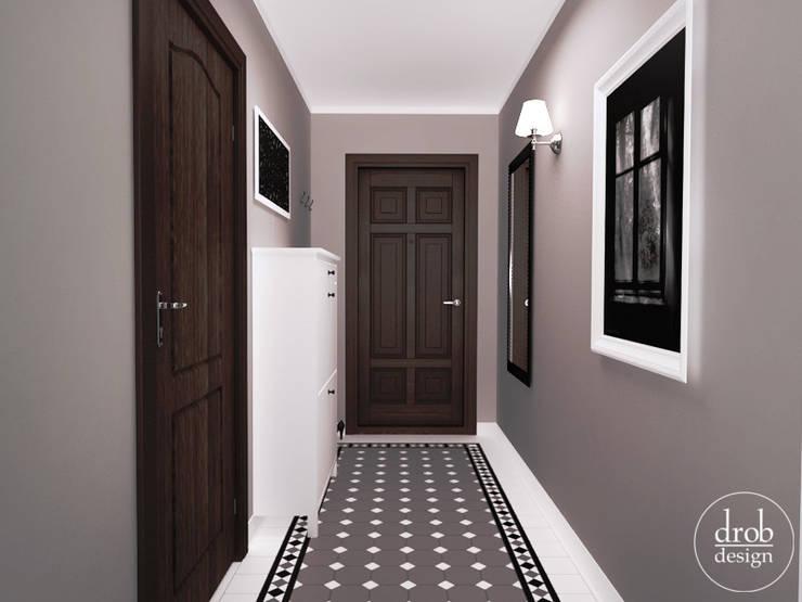Klasyczny Holl - mieszkanie w Lublinie. Widok na drzwi wyjściowe.: styl , w kategorii Korytarz, przedpokój zaprojektowany przez Drob Design ,Klasyczny Ceramiczny